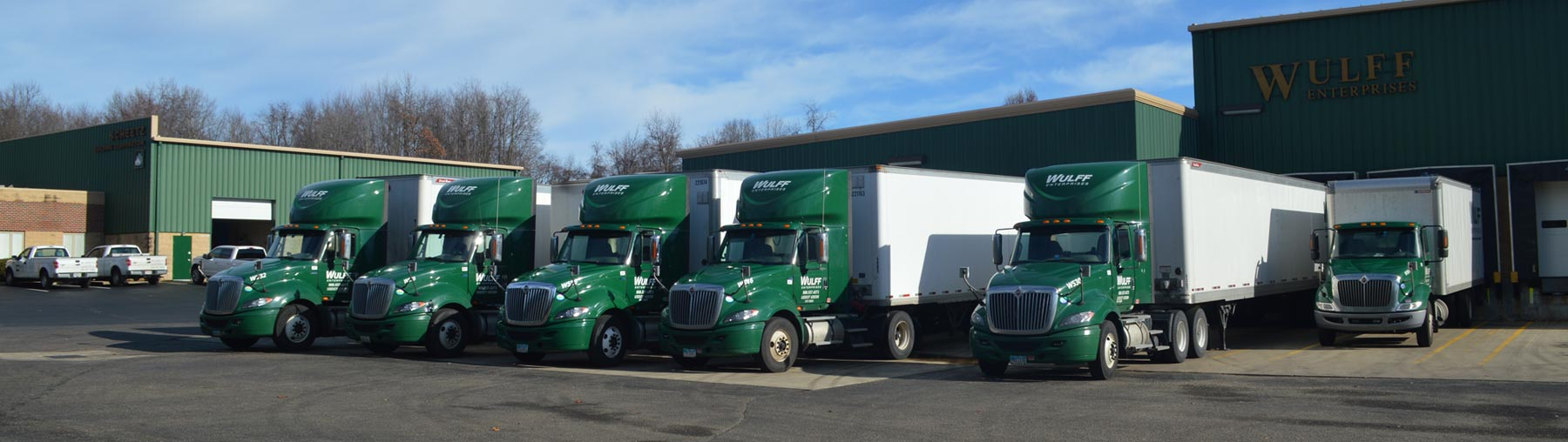 Fleet of green and white Wullf Enterprise tractor-trailers