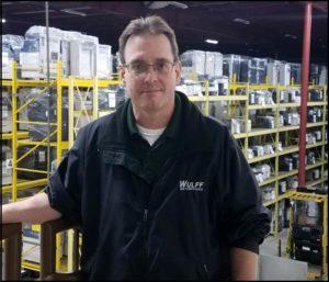 Steve, Sales Rep. in warehouse.